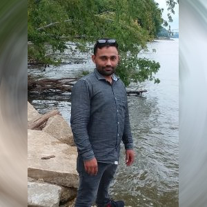 Picture of Vinit Kumar standing next to river